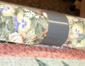 Another close-up view of temporary quilt clamps.