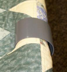 Close-up view of temporary quilt clamps.